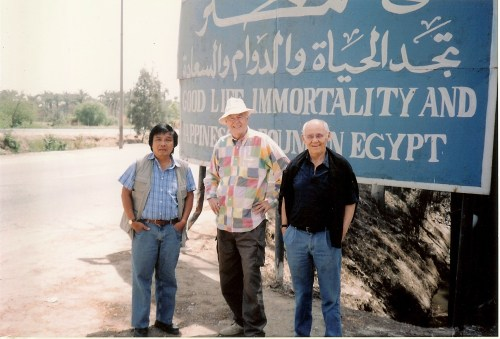 Linz standing in front of a sign on the way to Saqqara, which he used to proudly show to all his visitors. To his right stands his childhood friend Professor Erwin Haeberle. Used with permission.