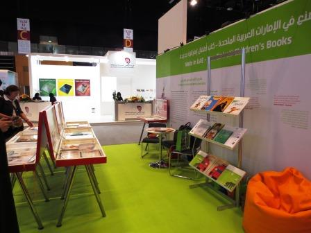 """The """"Made in UAE"""" stand displaying seven picture books that are the result of a joint workshop project of UAEBBY and the Goethe-Institut. Photo credit: MLQ."""