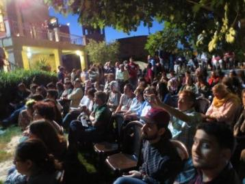 A packed crowd at the Sakakini Cultural Center of internationals and Palestinians; almost no one seemed to use headphones either for the English or the Arabic.