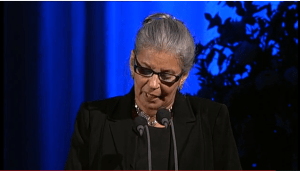 Anis receiving the award on Negm's behalf. Image snapped from livestream.