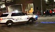 Pedestrian run over by Tacoma officer surrounded by crowd (Videos)