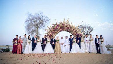 """Photo of حفل زفاف جماعي صيني عند """"بحيرات الحب"""" في دبي"""