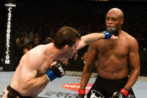 PHILADELPHIA - AUGUST 8:  Anderson Silva (black/yellow shorts) def. Forrest Griffin (tan shorts) - KO - 3:23 round 1 during UFC 101 at Wachovia Center on August 8, 2009 in Philadelphia, Pennsylvania.  (Photo by Josh Hedges/Zuffa LLC via Getty Images)