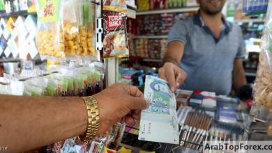 صورة هبوط قياسي للريال الإيراني أمام الدولار