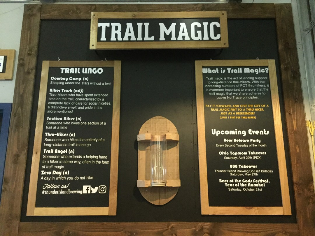 The Trail Magic Board at Thunder Island Brewing Company with trail lingo and instructions on how to participate