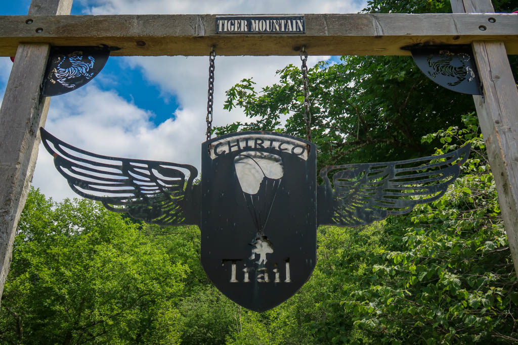 """An archway with a winged sign that reads """"Chirico Trail"""" and """"Tiger Mountain"""""""