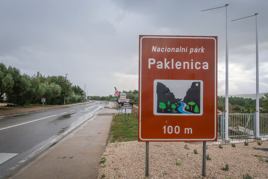 Road sign reads: Nacionali park Paklenica - 100m