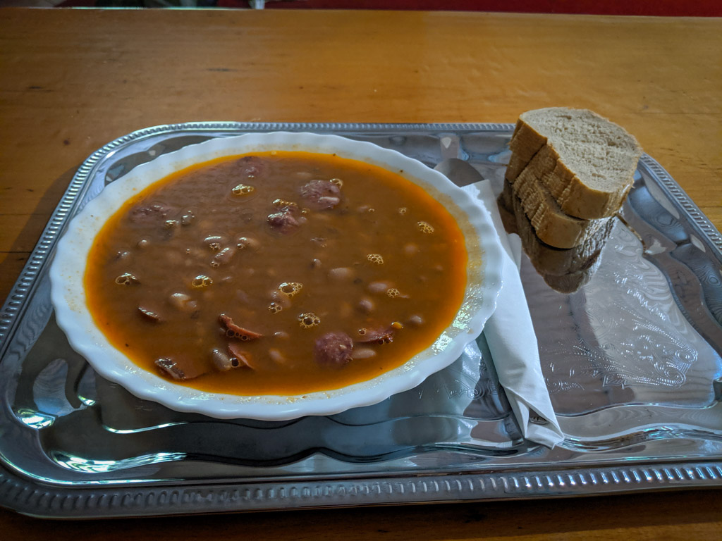 A hearty lunch of beans and sausage with homemade brown bread