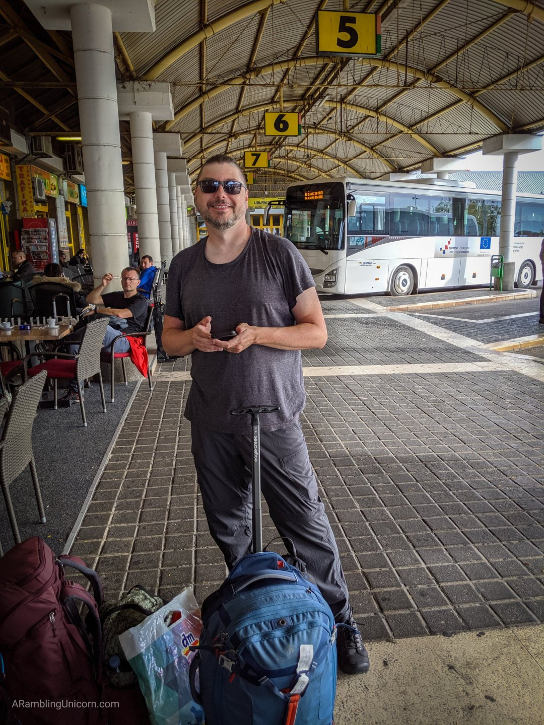 A photo of Daniel in the Zadar bus station with our bags.