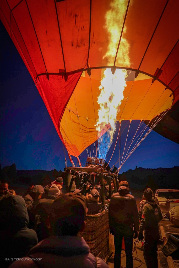 Climbing into the basket with 23 of my new closest friends as we set off on a Cappadocia balloon ride.
