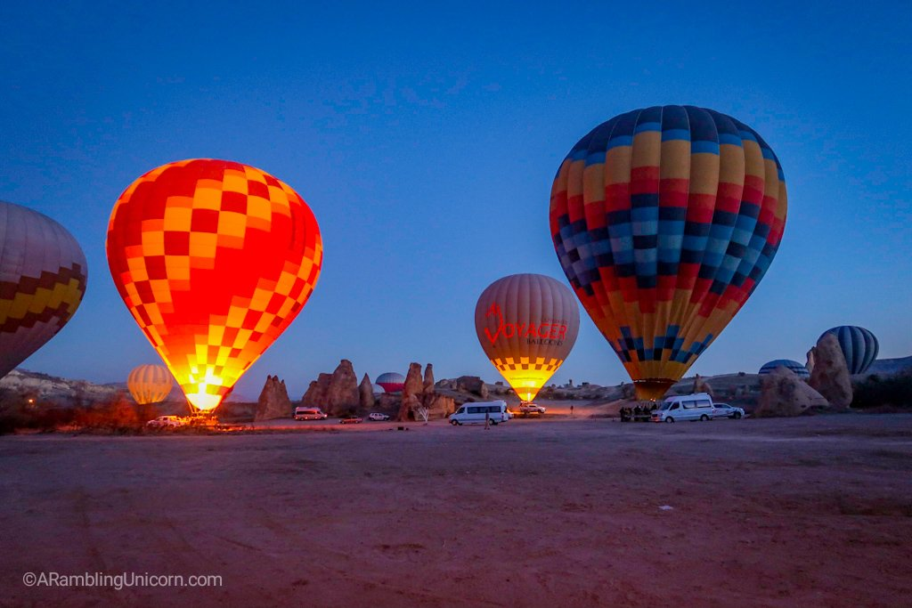 Watching the nearby balloons prepare for takeoff for a Cappadocia balloon ride.