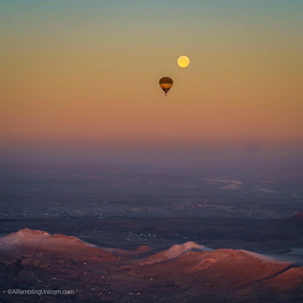 Cappadocia balloon ride with a full moon.