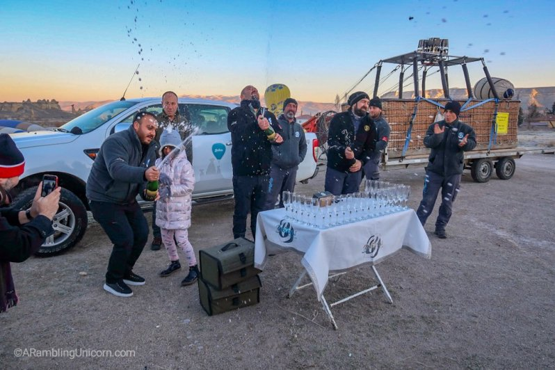 The Cappadocia balloon ride is over. Champagne celebration!
