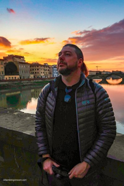 We are in Florence! In this photo, Daniel regards the sunset  from Ponte Santa Trinita.