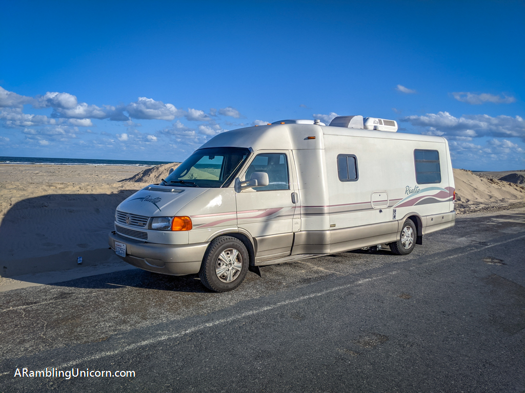 Appa is also enjoying our South Padre Island vacation while parked next to a sand dune