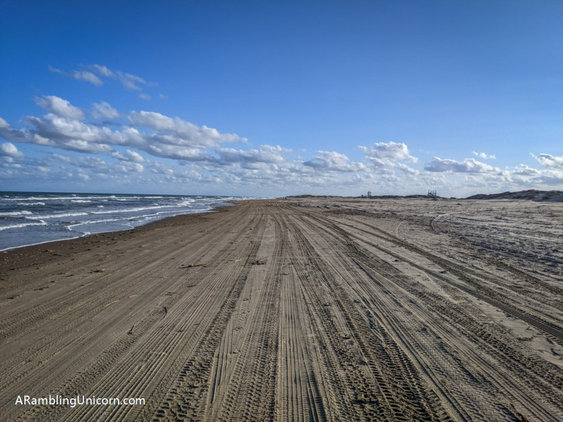The beach here is packed down and covered with tire tracks