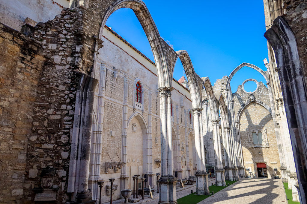 What used to be the interior of a large cathedral with arched columns now is an outdoor space as the roof is missing