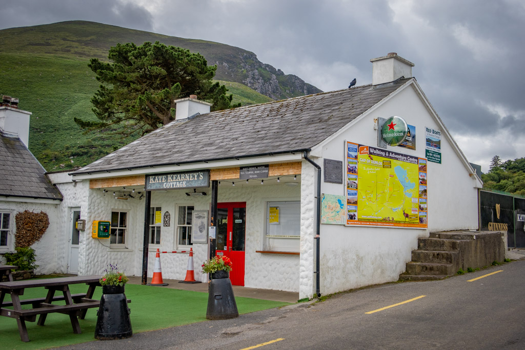 Kate Kearney's Cottage Marks the beginning of the Gap of Dunloe Walk. It is a quaint little building painted white with a red door and picnic tables set outside.