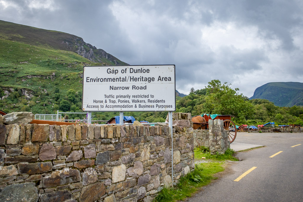 """The sign reads """"Gap of Dunloe Environmental / Heritage Area. Narrow Road. Traffic primarily restricted to Horse & Trap, Ponies, Walkers, Residents, Access to Accommodation & Business Purposes""""."""