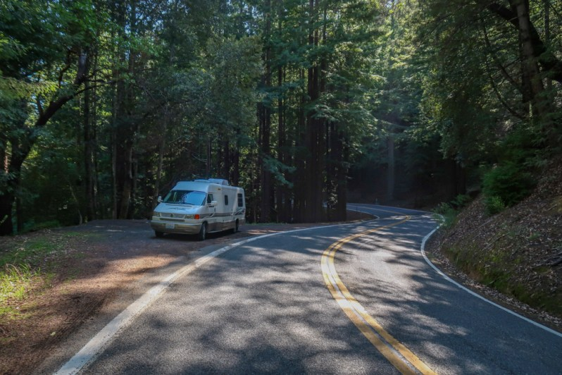 Our 21-foot RV, Appa, parked on the side of a curving road in the woods on Highway 1