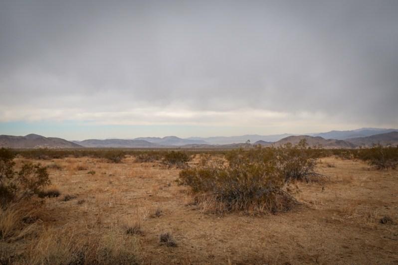 High desert landscape with dark cloudy skies
