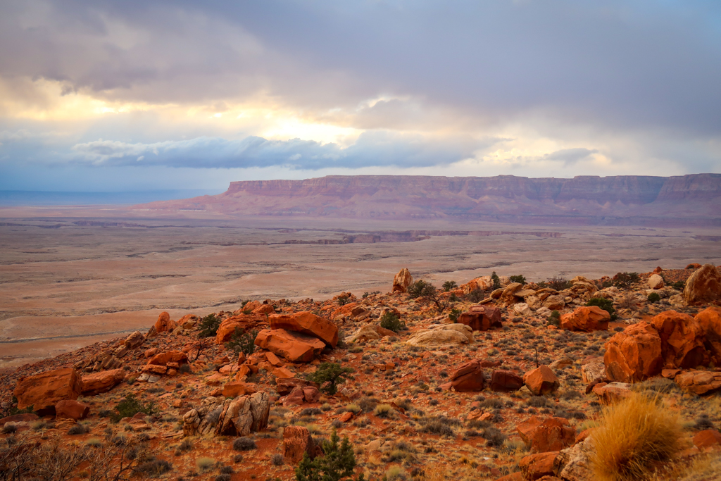 View of the Vermillion Cliffs from Antelope Pass Vista. The red walls rise dramatically from the plateau to form towering Vermillion Cliffs.