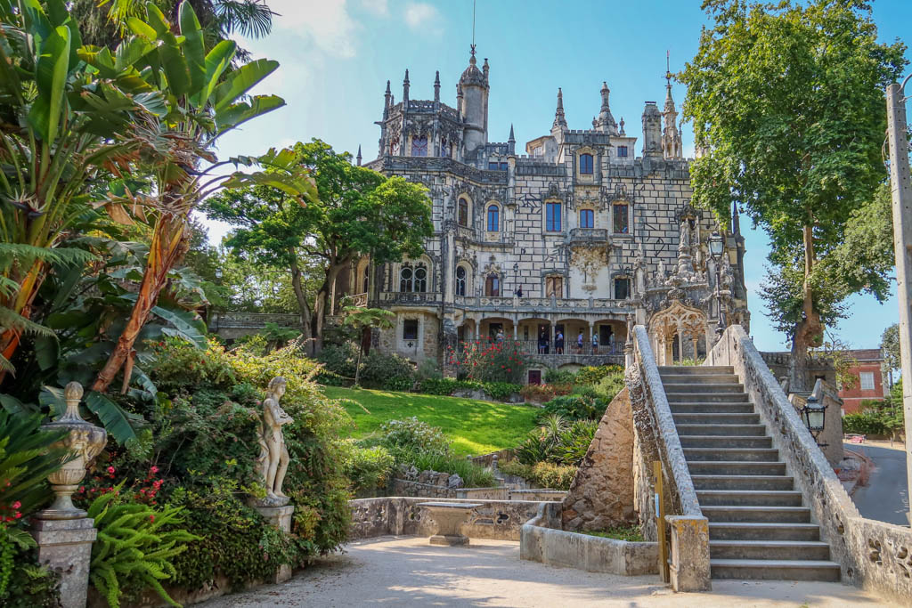Steps lead to Quinta da Regaleira which is adorned with ornate fixtures and gothic spires