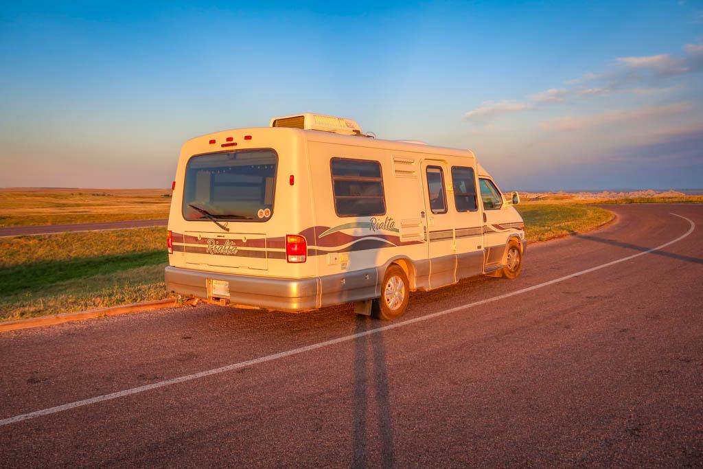 Winnebago Rialta parked at Badlands National Park, South Dakota at sunset