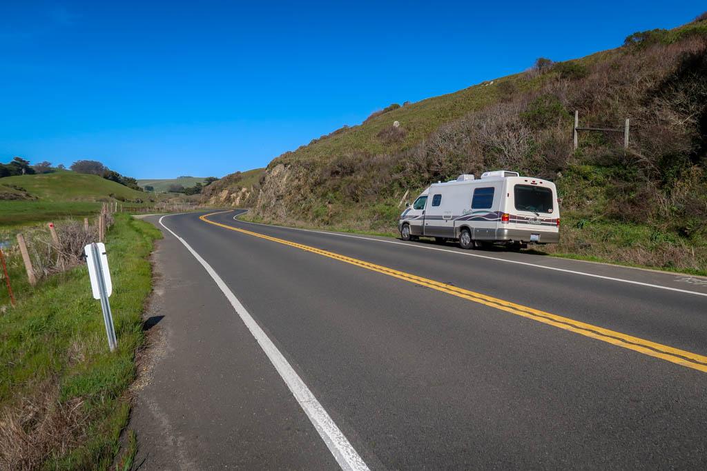 Winnebago Rialta parked along the Pacific Coast Highway through some farmlands in California