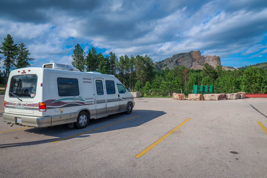 Winnebago Rialta parked in front of the partially-finished Crazy horse Monument.