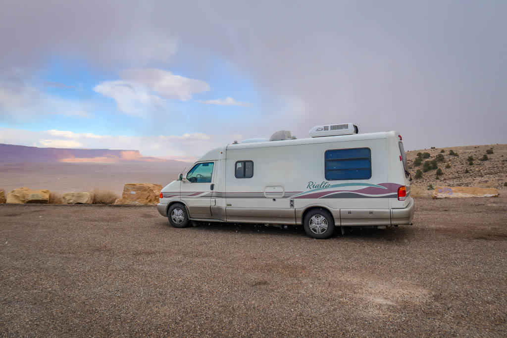 Winnebago Rialta parked at the Pasture Canyon Lookout with views of the Vermillion Cliffs in the distance