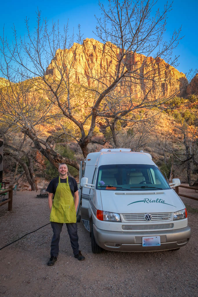 Our Rialta Motorhome is parked at a campsite right by the Virgin River with Zion Canyon in the background