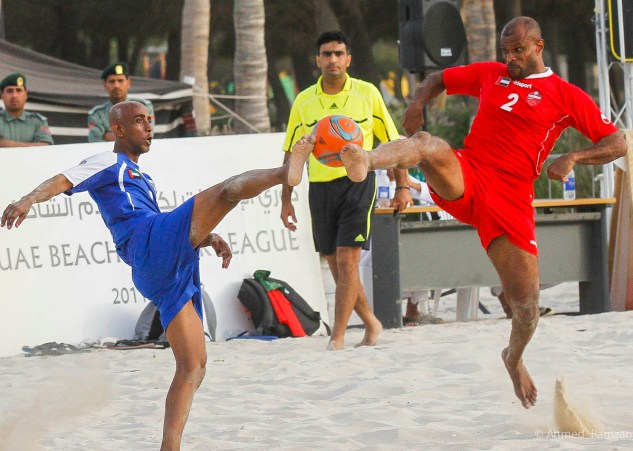 Qambar Mohammad Ali from Al Ahli Club in action against Ali Hassan Kareem from Al Nasr Club, during the semi final matc of Beach Soccer at Al Mamzar Park Beach in Dubai.