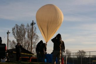 EOSS Fills ACC DemoSat team balloon with hydrogen before the launch in Eaton Colorado on April 9 2016