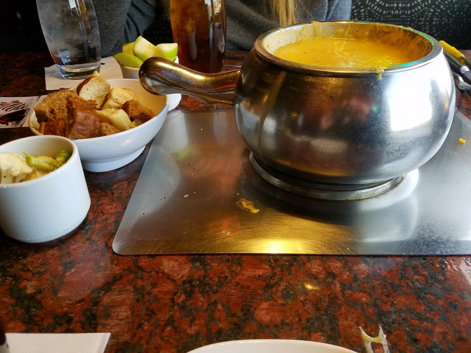 The Wisconsin Cheddar Fondue served with Granny Smith apples, bread and fresh broccoli at The Melting Pot in Littleton, Colo., April 3, 2018.