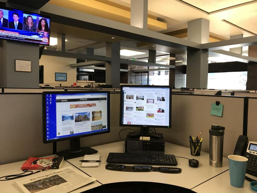 A+look+at+my+work+station+at+The+Gazette.+Having+two+monitors+is+essential+in+order+to+keep+up+with+the+flow+of+news.+So+is+coffee.