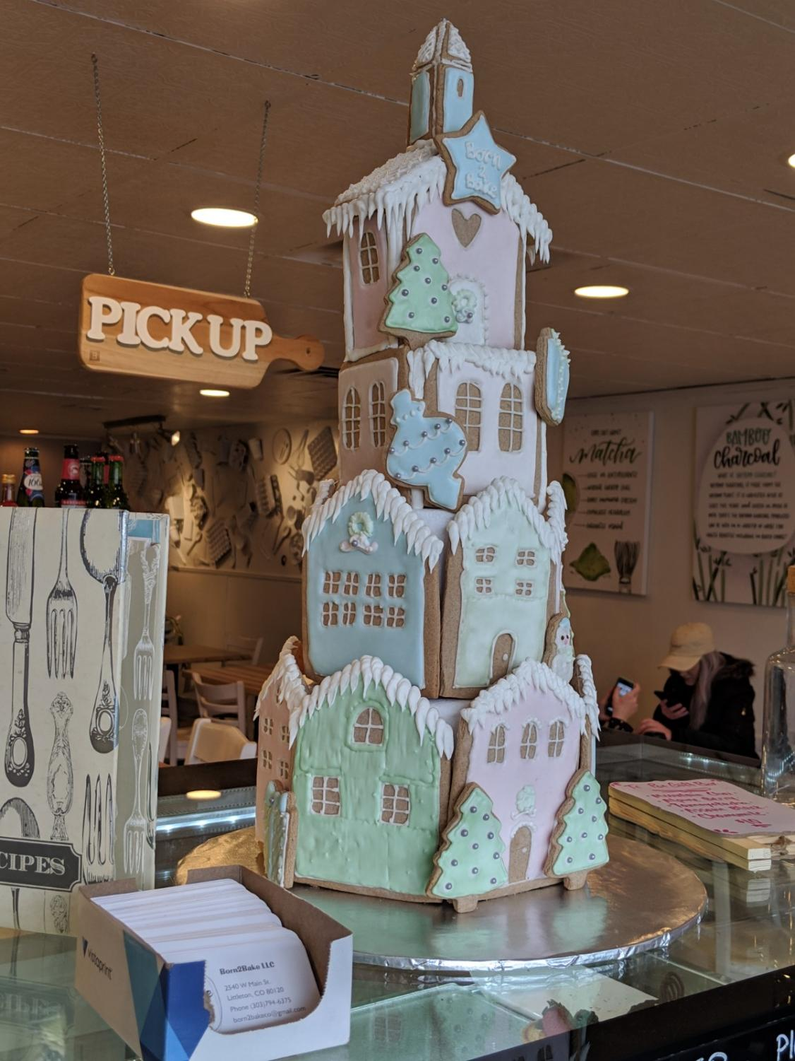 A gingerbread cookie house on display at Born2Bake bakery cafe