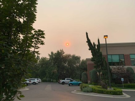 Photo of the sun in a sky full of smoke.