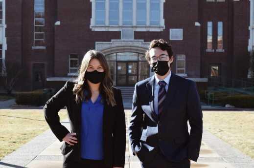 Kenneth Huston, ASBSU president, and Sarah Smith, ASBSU vice president, posing on campus, wearing masks.