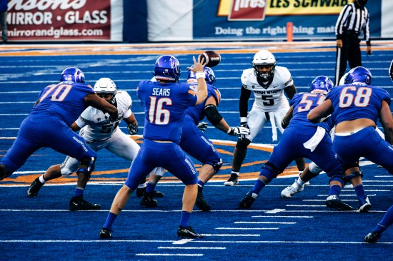 Jack Sears on the blue field playing in a home football game at Boise State.