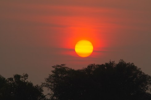 Smokey skies and a red sun in Boise.