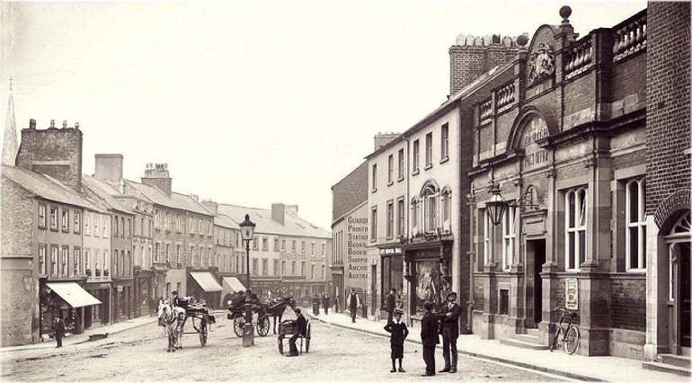 Upper English-street in Armagh, looking south from the intersection at College-street; the Post Office building in the right foreground, and the northern edge of the Armagh Guardian building visible in the right mid-ground.
