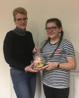"Ailish, winner of ""Guess the number of sweets in the jar"" competition with Band President, Ann Ness"