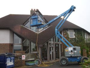 Preparing high level external timbers to receive a preserving treatment