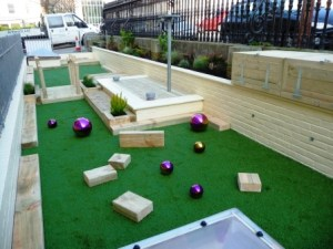 A custom designed and installed play area for a primary school in Brighton. Simple, bold shapes and colours are often all kids need to have fun