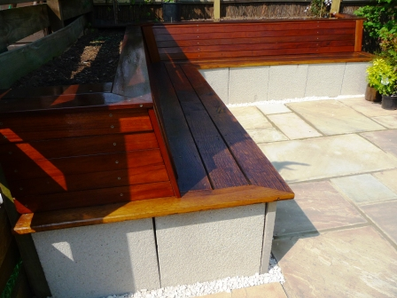 Ipe hardwood decking with reclaimed oak and saxon white and indian sandstone  pavers