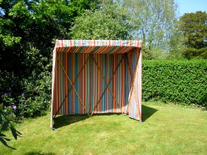 The riotous colours of Deckchair Stripes' 'Bowling' Sunshelter