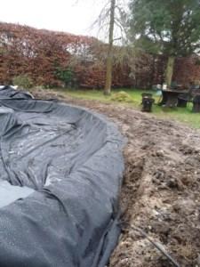 pond liner being installed