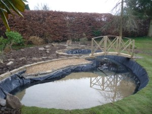 The pond now starts to fill after a good clean out