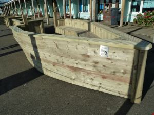 Softwood seating in the shape of a boat